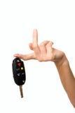 Bibelot avec s'arrêter principal de véhicule sur un doigt femelle image libre de droits
