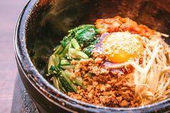 Bibimbap in a heated stone bowl, Korean food. Cooking in Korean Style. Korean Cuisine Royalty Free Stock Photos