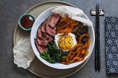 Bibimbap, Korean beef and vegetables. Bibimbap, traditional Korean beef and vegetables dish with fried egg stock image
