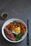 Bibimbap, Korean beef and vegetables. Bibimbap, traditional Korean beef and vegetables dish with fried egg stock photo