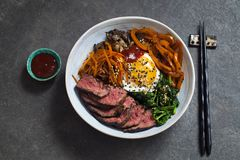 Bibimbap, Korean beef and vegetables. Bibimbap, traditional Korean beef and vegetables dish with fried egg royalty free stock image