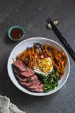 Bibimbap, Korean beef and vegetables. Bibimbap, traditional Korean beef and vegetables dish with fried egg royalty free stock photos
