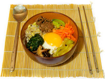 Bibimpab korean dish. With vegetables, beef and egg on rice stock photography