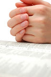 Bible. Praying hands on an open bible Stock Images