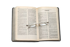 Bible. On a phoyo Holy Bible with glases on white background Royalty Free Stock Image