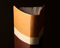 Bible. A brown Bible standing on one end royalty free stock photography