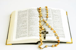 Bible. Open on st Mark with vintage rosary beads stock photography