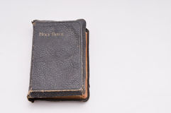 Bible 2. Very old bible sits closed on white with room for copyspace Stock Image
