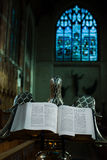 Bible. Open Bible on a lectern in the chapel of Selwyn college, Cambridge university, England stock photography