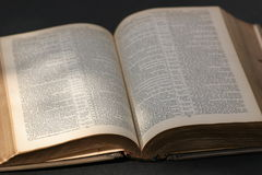 The Bible. Old English Bible on a black background royalty free stock photo