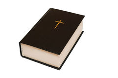 Bible. A black cover with a gold cross on white Royalty Free Stock Image