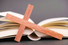 Bible abstract. Wooden cross leaning against a book as a concept for the bible Royalty Free Stock Photography