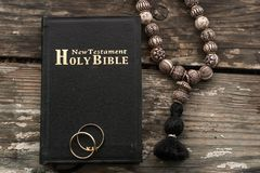 The bible is the base where upon two wedding rings rest. Wedding symbols, attributes. Holiday, celebration royalty free stock images