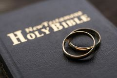 The bible is the base where upon two wedding rings rest. Wedding symbols, attributes. Holiday, celebration royalty free stock photos