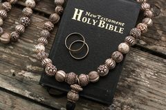The bible is the base where upon two wedding rings rest. Wedding symbols, attributes. Holiday, celebration stock image