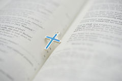 Bible and the blue Cruxific Stock Photo
