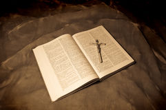 Bible book with crucifixion Stock Photo