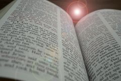 Bible book open for background. And inspiration stock photography