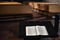 Bible. A Bible book opened on a wooden table.Inside Scherzligen Church from Thun Switzerland. Deutsch language Royalty Free Stock Photo