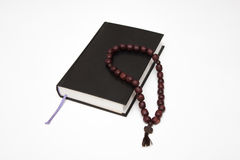 Bible book and rosary  on white. Background Stock Image