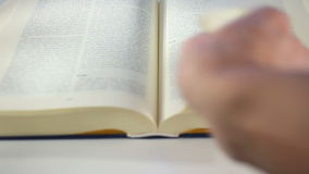 Bible Book scrolling stock video footage