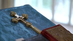 Books and golden cross in church stock video footage