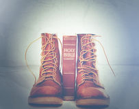 Bible and boots Royalty Free Stock Image