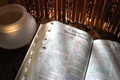 Bible with candle Stock Images