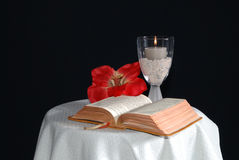 Bible with candle and flower Stock Image