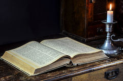 Bible and candle Stock Photography