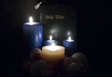 Bible by candle light Stock Images