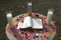 Bible and Candles. Wedding day outdoor with bible and candles Stock Photos