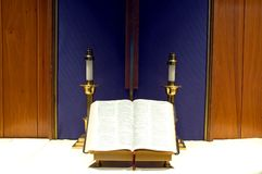 Bible and candles on altar Stock Photography