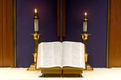 Bible and candles on altar royalty free stock photo