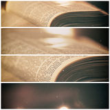 Bible with candles. In the background. Low light scene with a multi panel aged and grain effect Stock Photo