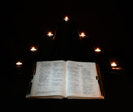 Bible with candles Stock Photography