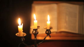 Bible and candles stock video