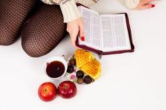 Bible, candy and tea Royalty Free Stock Photos