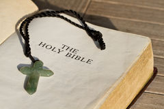 Bible Central Message: The Cross. The Holy Bible and the cross stock photo