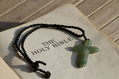 Bible Central Message: The Cross. The Holy Bible and the cross stock photography