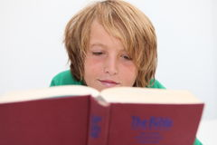 Bible child. Christian child reading the bible Stock Photos