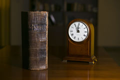 Bible and clock. Together in a Library Stock Images