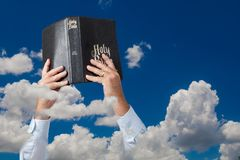 Bible in clouds Stock Photos