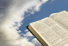 Bible With Clouds. A Bible pictured in the sky with clouds Royalty Free Stock Image
