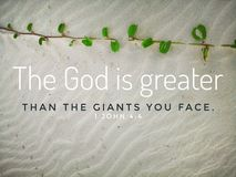God is greater with bible verse design for Christianity with sandy beach background.