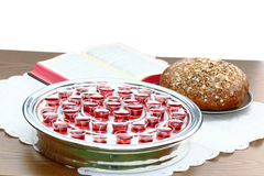 Bible, and communion silver plate with bread. Stock Images