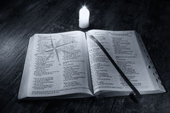 Bible with compass on good message with candle light Royalty Free Stock Photos