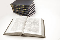 Bible conceptual image. Bible and other books on isolated background Stock Photos