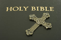 Bible with a cross Stock Photography