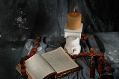 Bible cross candle and beads Royalty Free Stock Image
